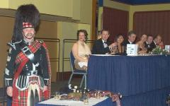 Pipe Major Iain Grant about to 'address the haggis'