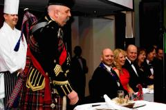 Pipe Major Ian Grant addressing the haggis, watched by SPRA President, Barry Coughlan, and his top table guests